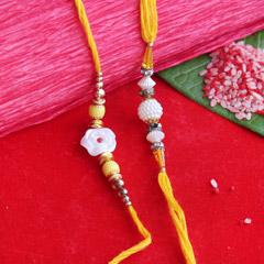 Artistically Designed White Pearl Rakhis