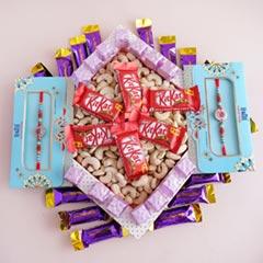 Two AD Rakhis with Chocolates N Cashews