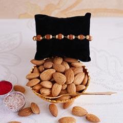 Rudraksha Rakhi with Golden Bowl Set N Almonds