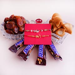 Two Peacock Rakhis with Dates N Snacks