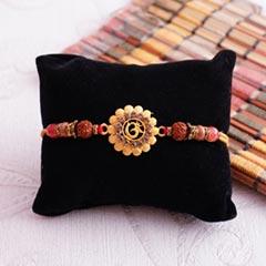 Golden OM Rakhi with Rudraksha