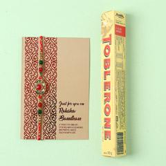 Vibrant Designer Rakhi And Toblerone Combo