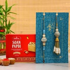 Blue Orb Pearl And Lumba Rakhi Set With Soan Papdi