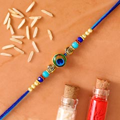 Circular Peacock Feather Rakhi