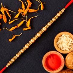 Traditional Pearl And Mauli Rakhi - Send Rakhi to UAE