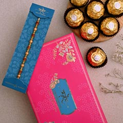 Traditional Golden Pearl Rakhi And 3 Pcs Ferrero Rocher - Send Rakhi to UAE