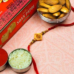 Om Rakhi With Soan Papdi & Almonds